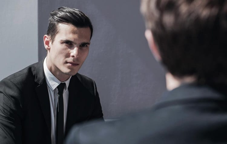 a man listening attentively during a meeting