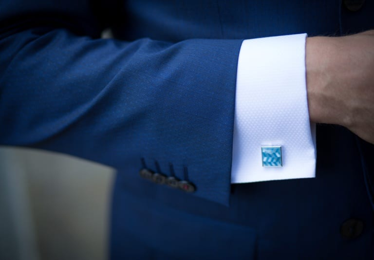 sleeves of a blue suit jacket