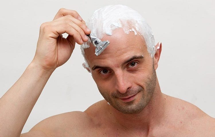 applying shaving cream on head